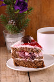 Cake on wooden background with flowers and tea cup Royalty Free Stock Photography