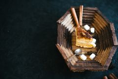 Cake on a wooden tray on a black matte background stock photo