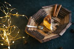 Cake on a wooden tray on a black matte background Stock Photography