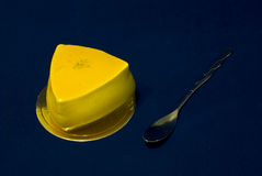 Cake. Yellow Triangle cake with spoon Royalty Free Stock Photography