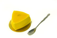 Cake. Yellow Triangle cake with spoon in pure white background Stock Photos