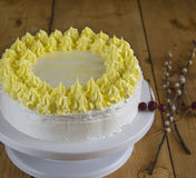 Cake with yellow and white cream. Lying on the wooden table Stock Images