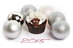 Cakelam met zilveren Kerstmisballen als simbol 2015 nieuwe jaren i Royalty-vrije Stock Afbeelding