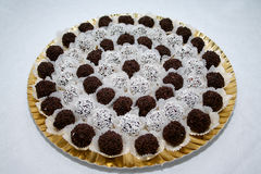 Cakes. Many little cocoa cookies on a plate Royalty Free Stock Photography