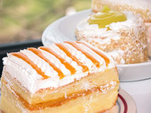 Cakes. Close-up of delicious mango and lemon sponge cakes Royalty Free Stock Photos