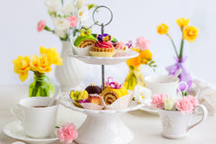 Cakes for afternoon tea. Assorted cakes and pastries on a cake stand for afternoon tea Royalty Free Stock Photos