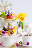 Cakes for afternoon tea. Assorted cakes and pastries on a cake stand for afternoon tea Royalty Free Stock Photography