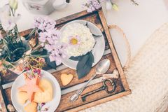 Cakes on beautiful wooden tray with flowers. Spring mood still life photo for holiday design Stock Photography
