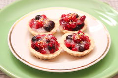Cakes with berries Stock Images