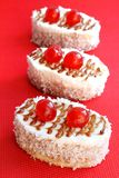 Cakes with biscuit, butter cream and coconut Stock Image