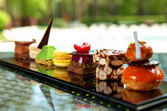 Cakes and biscuits. Gorgeous view of different cakes and biscuits, served in outdoors Royalty Free Stock Photography