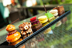Cakes and biscuits. Gorgeous view of different cakes and biscuits, served in outdoors Royalty Free Stock Photos