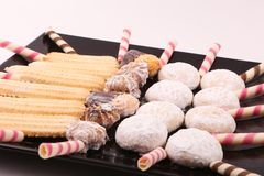 Petits fours, cakes and biscuits. Cakes, biscuits and petits fours presented in a black dish Stock Photography