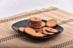 Cakes biscuits sandwich on a plate royalty free stock photo