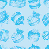 Cakes blue seamless pattern. Light blue monochrome seamless pattern with graphic hand-drawn cakes. Vector and raster versions Stock Photos