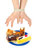 Cakes and bound hands Stock Image