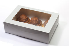 Cakes in box. Three cakes in a paper box over white background Royalty Free Stock Image