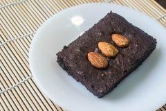 Cakes, brownies, sprinkle almonds. Royalty Free Stock Photo