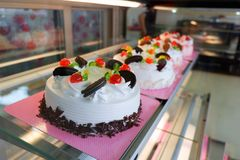 Cakes in a cake shop. Cakes in a cake and Bakery shop - Cake shop with a variety of cakes on display stock photo