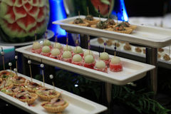Cakes canape. On a plate at the buffet stock images