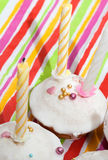 Cakes with candles. Cakes covered with icing sugar and nonpareil Stock Image