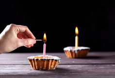 Cakes with candles Stock Photos