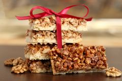 Cakes with caramelized walnuts. Stock Photos