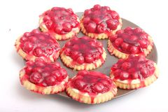 Cakes with cherries Stock Images