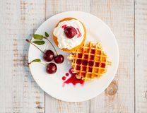 Cakes with cherry Stock Images