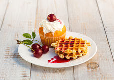 Cakes with cherry Royalty Free Stock Image