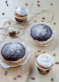 Cakes with chocolate and coconuts decorated with dried cloves and twine. Royalty Free Stock Photo