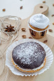 Cakes with chocolate and coconuts decorated with dried cloves and twine. Stock Photography