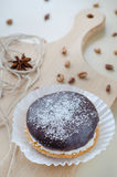 Cakes with chocolate and coconuts decorated with dried cloves and twine. Royalty Free Stock Image