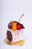 Cakes, chocolates, fruit. Royalty Free Stock Photo