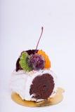 Cakes, chocolates, fruit. Stock Images