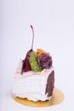 Cakes, chocolates, fruit. Stock Image