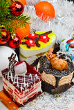 Cakes on christmas background with snow. Confetti and twig pine stock image
