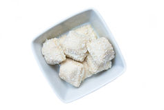 Cakes with coconut on a square bowl seen from above Royalty Free Stock Image