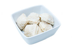 Cakes with coconut on a square bowl Royalty Free Stock Photo