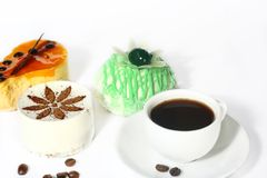 Cakes and coffee. On white background Royalty Free Stock Image