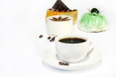 Cakes and coffee. On white background Royalty Free Stock Photo