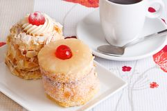 Cakes and coffee. Two decorated cakes and a coffee cup Stock Photo