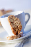Cakes with coffee on background. Cantucci cakes with coffee on background Stock Image