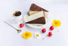 Cakes, coffee, cherries and flowers Stock Photos