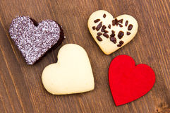 Cakes and cookies in the shape of heart on wood from above Royalty Free Stock Photo