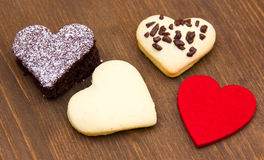 Cakes and cookies in the shape of heart on wood Royalty Free Stock Photo
