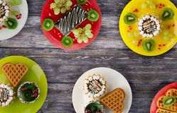 Cakes, cookies waffles on the table royalty free stock photography