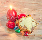Cakes Cozonac with smashed nuts, traditional colored easter egg, Stock Photography