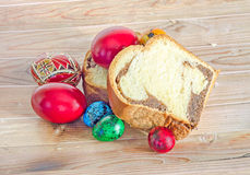 Cakes Cozonac with smashed nuts, traditional colored easter egg, Stock Images