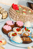 Cakes with cream, grated chocolate, sugar powder. Baking sweets for dessert in the shop window Royalty Free Stock Images